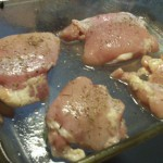 Season thighs with salt, pepper and thyme.
